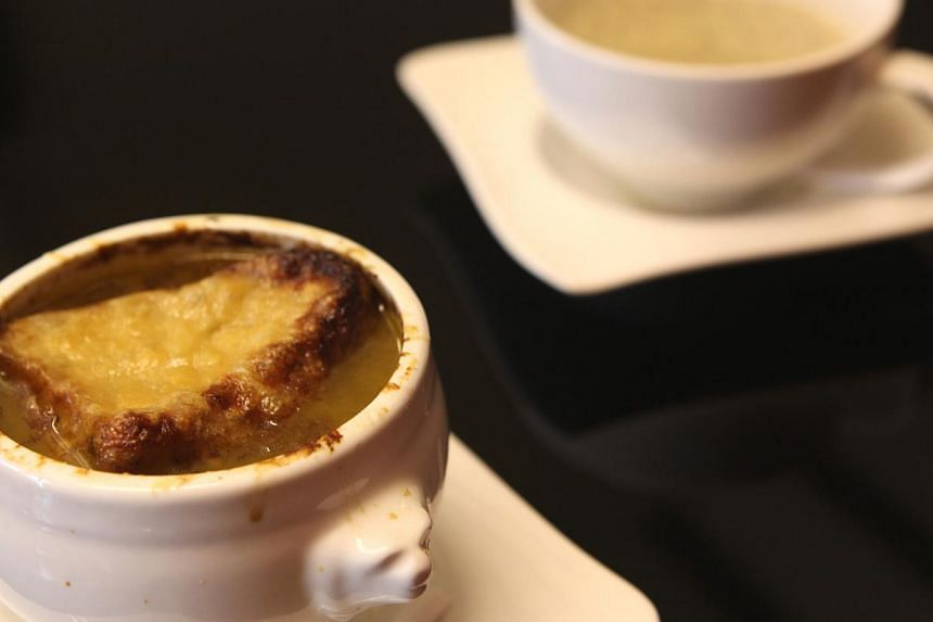 Traditional French onion soup from Le Bistro Parisien. -- ST PHOTO: DELON HO