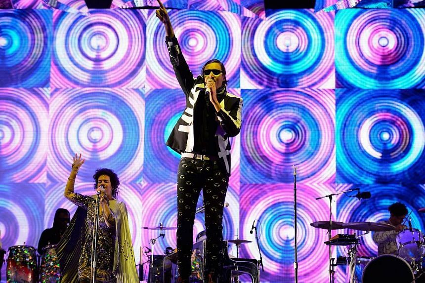 Canadian band Arcade Fire headlines the Pyramid Stage on the first official day of the Glastonbury Festival of Music and Performing Arts on Worthy Farm in Somerset, south-west England, on June 27, 2014. -- PHOTO: AFP