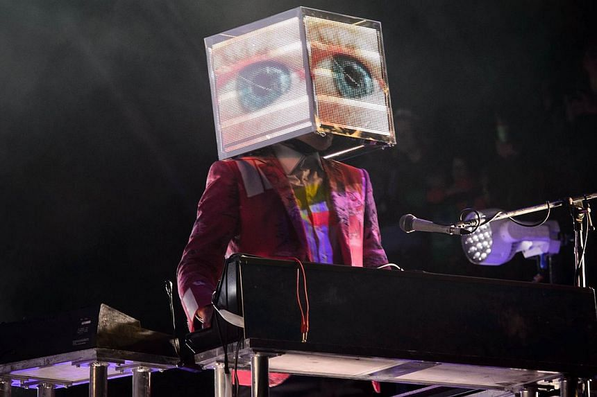 A member of Canadian band Arcade Fire plays keyboards as the group headlines the Pyramid Stage on the first official day of the Glastonbury Festival of Music and Performing Arts on Worthy Farm in Somerset, south-west England, on June 27, 2014. -- PHO