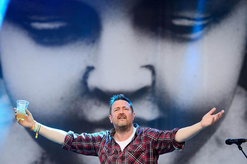 Guy Garvey of British band Elbow, performs on the Pyramid Stage, on the first official day of the Glastonbury Festival of Music and Performing Arts in Somerset, south-west England, on June 27, 2014. -- PHOTO: AFP