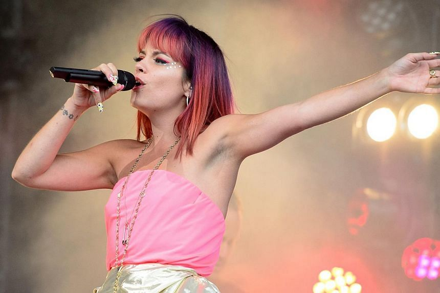 British singer Lily Allen performs on the Pyramid Stage, on the first official day of the Glastonbury Festival of Music and Performing Arts in Somerset, south-west England, on June 27, 2014. -- PHOTO: AFP