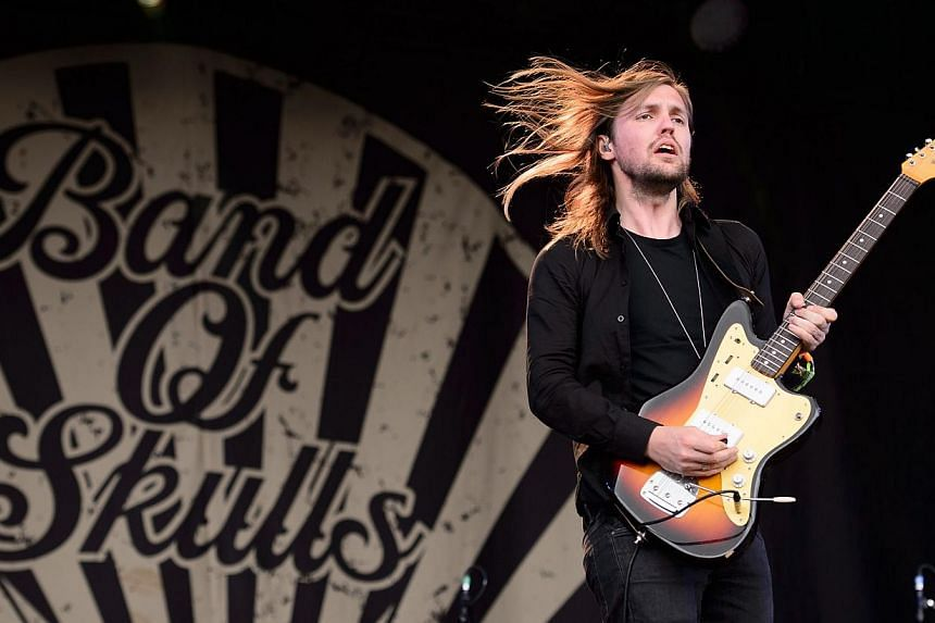 Russell Marsden, guitarist and singer from British band Band Of Skulls, performs on the Other Stage, on the first official day of the Glastonbury Festival of Music and Performing Arts in Somerset, south-west England, on June 27, 2014. -- PHOTO: AFP