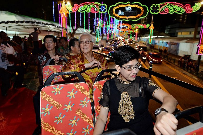 Associate Professor Fatimah Lateefand other guests attend the official launch of Hari Raya Light Up 2014. -- PHOTO: BERITA HARIAN