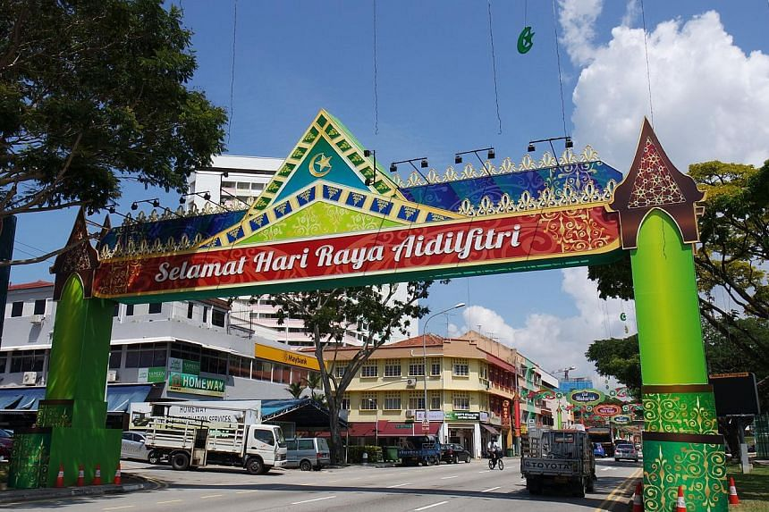 This year's Hari Raya Light-Up stretches over 1.3km and covers Sims Avenue, and Geylang and Changi roads. Lining the streets are arches featuring traditional Malay motifs and architecture.-- ST PHOTO: AUDREY TAN