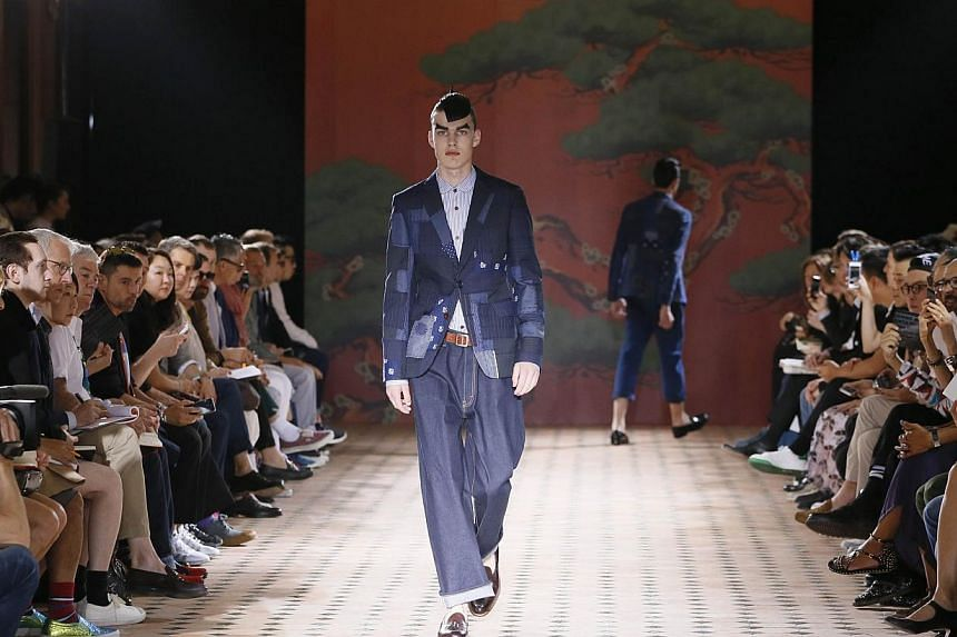 A model presents a creation by Junya Watanabe Man during the men's 2015 spring-summer collections in Paris on June 27, 2014. -- PHOTO: AFP
