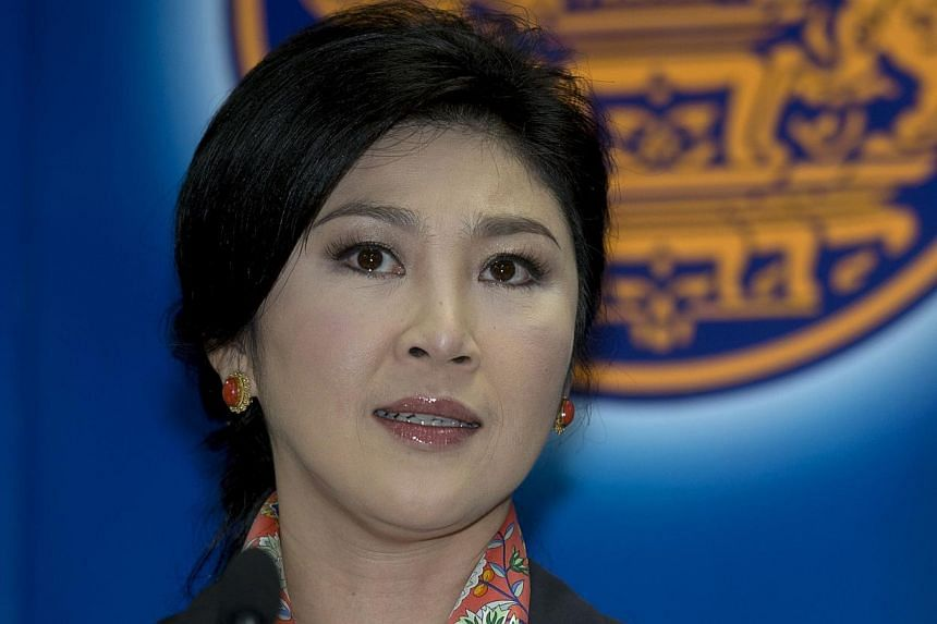 Thai Prime Minister Yingluck Shinawatra answers questions from the media during a press conference at the permanent secretary for defence suburb of Bangkok on May 7, 2014. -- PHOTO: AFP