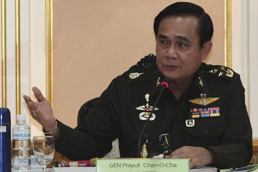 Thai Army chief General Prayuth Chan-ocha speaks during a meeting with members of the International Chamber of Commerce at the Royal Thai Army Headquarters in Bangkok June 19, 2014. -- PHOTO: REUTERS