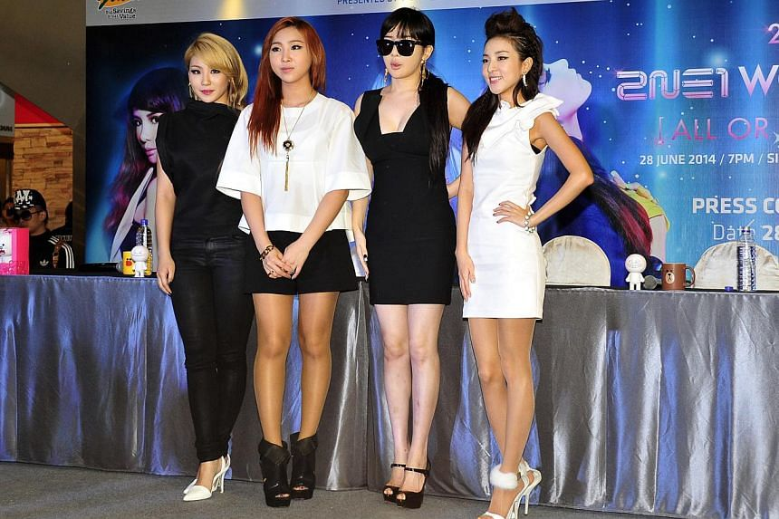 K-pop band 2NE1 at the press conference for their world tour at Square2. -- ST PHOTO: DIOS VINCOY JR FOR THE STRAITS TIMES