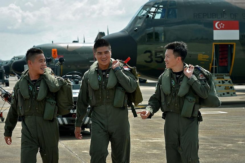 (From left) 1st Sergeant Eng Guan Peng, 26, Lieutenant-Colonel Wong Hong Kai, 33, Major Darrell Goh, 33 of 122 Squadron. 122 Squadron, which privided aid relief when Super Typhoon Haiyan hit the Philippines, won the Best Air Combat Support Unit for t