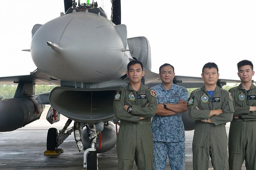 (From left) Lieutenant Emil Vincent Lina Lau, 27, Military Expert 2, Aloysius Lye, 38, Lieutenant-Colonel Lim Kok Hong, 38, and Lieutenant Yap Yong Wei, 26 of 145 Squadron. 145 Squadron was named the Best Fighter Squadron.-- ST PHOTO: NG SOR LU