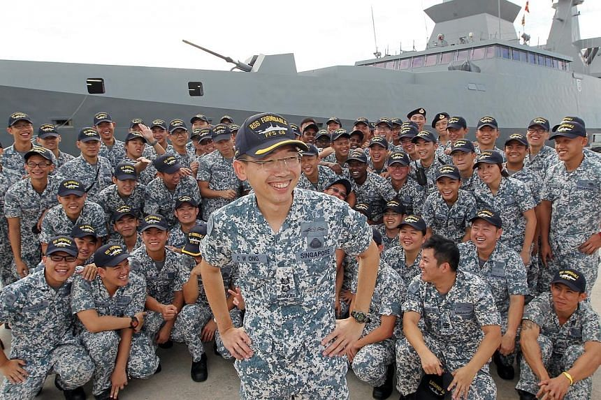 Lieutenant-Colonel Ong Chee Wei, 41, Commanding Officer of RSS Formidable, with his crew in front of their ship. The RSS Formidable has won Best Ship for the second time in the SAF Day Best Unit Competition.-- ST PHOTO: SEAH KWANG PENG