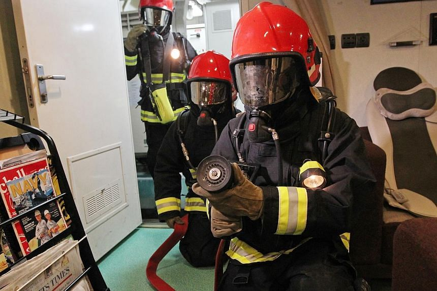 Crew of RSS Formidable undergo and fire damage control drill in a recreation room. The RSS Formidable has won Best Ship for the second time in the SAF Day Best Unit Competition.-- ST PHOTO: SEAH KWANG PENG