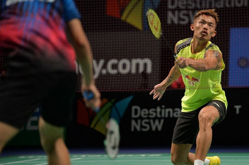 Lin Dan of China (right) hits a return to Simon Santosa of Indonesia (left) in the men's singles final at the Australia Open badminton tournament in Sydney on June 29, 2014. Lin Dan won the match 22-24 21-16 21-7.Chinese superstar Lin Dan fough