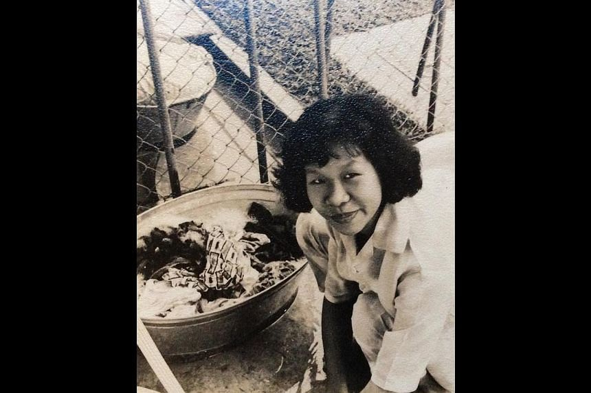 Madam Goh Kah Keow, 74, who worked as a washer woman (above) and factory worker, among other jobs. -- PHOTO: COURTESY OF GOH KAH KEOW
