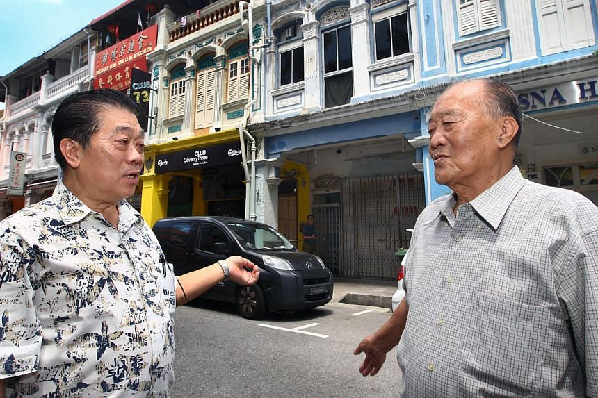 Mr Ding Chin Hock (left) and Mr Tan Ah Mok, 84, in front of their former Maude Road homes. One of the shophouses, No. 81, was a boarding house for Mr Koh Teong Koo and other Hock Chia rickshaw pullers.
