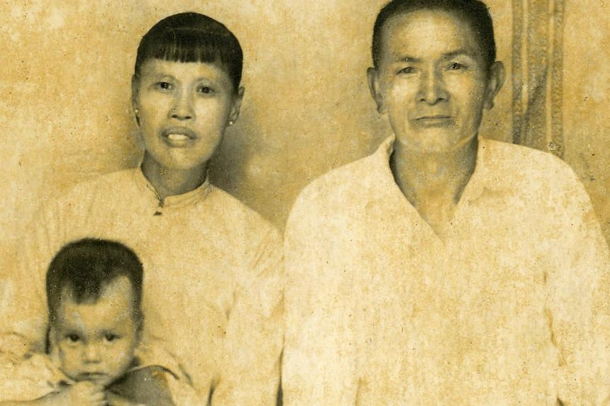 (From left) Mr Koh Teong Koo with his wife, Madam Sit Chu Song, photographed with their eldest son Ko Ming Chiu in a photo taken in the 1940s. Mr Lee Kuan Yew (in black) with his family members, comprising siblings (clockwise from left) Monica, Denni