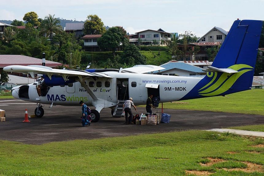 Malaysia Airlines' Twin Otter plane (left) seats 18 people but will often take only about a dozen, depending on the weight of the cargo.