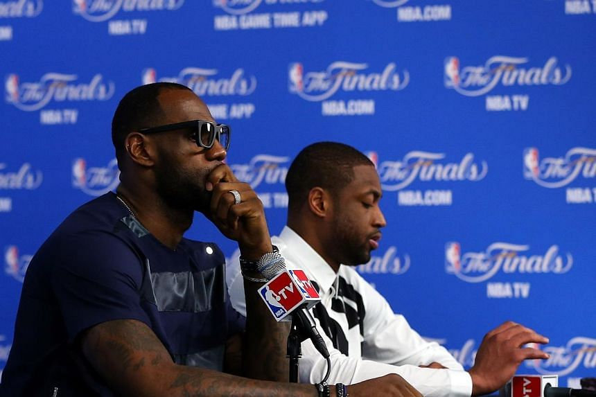 LeBron James #6 and Dwyane Wade #3 of the Miami Heat speak to the media following a 104-87 loss in Game Five of the 2014 NBA Finals at the AT&T Center on June 15, 2014 in San Antonio, Texas.Miami Heat star Dwyane Wade will join LeBron James
