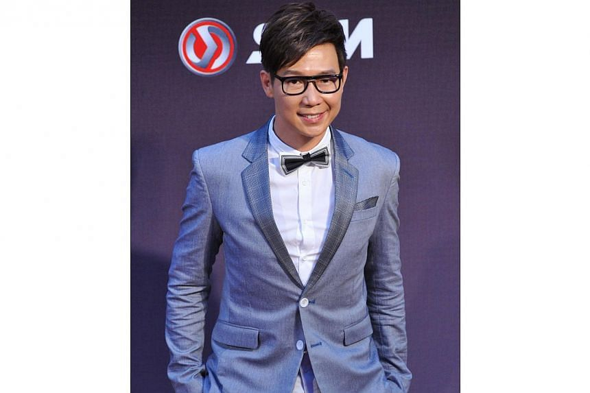 Malaysian singer Victor Wong arrives at the 25th Golden Melody Awards in Taipei on June 28, 2014. -- PHOTO: AFP
