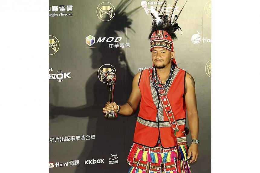 Taiwan singer Ayal Komod, also known as Chang Chen-yue, poses after winning the Mandarin Album of the Year award at the 25th Golden Melody Awards in Taipei on June 28, 2014. -- PHOTO: REUTERS