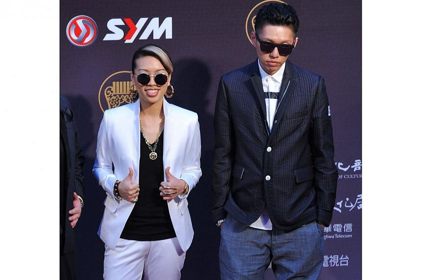 Taiwanese rapper Soft Lipa (right) and Taiwanese singer Miss Ko (left) arrive at the 25th Golden Melody Awards in Taipei on June 28, 2014. -- PHOTO: AFP