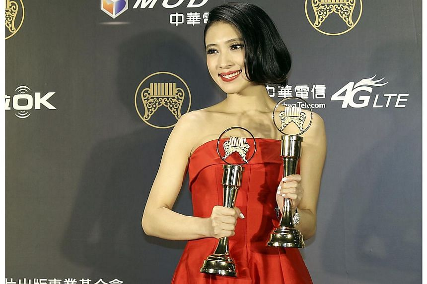 Malaysian singer Penny Tai poses after winning the Best Mandarin Female Artist and Best Producer awards at the 25th Golden Melody Awards in Taipei on June 28, 2014. -- PHOTO: REUTERS