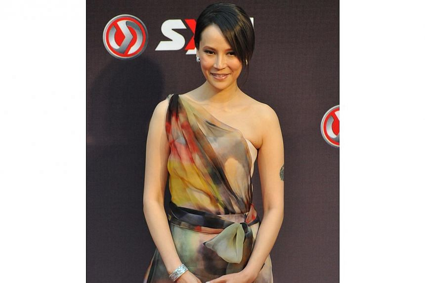 Taiwanese singer Faith Yang arrives at the 25th Golden Melody Awards in Taipei on June 28, 2014. -- PHOTO: AFP