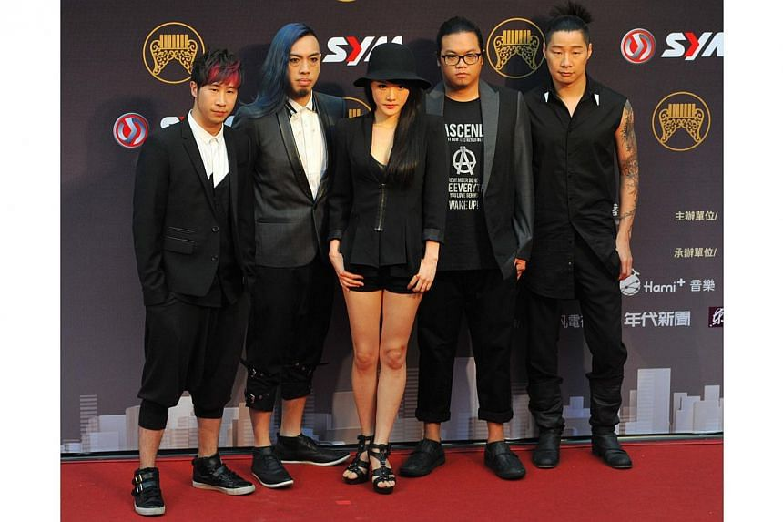 Taiwanese band ChthoniC. arrives at the 25th Golden Melody Awards in Taipei on June 28, 2014. -- PHOTO: AFP