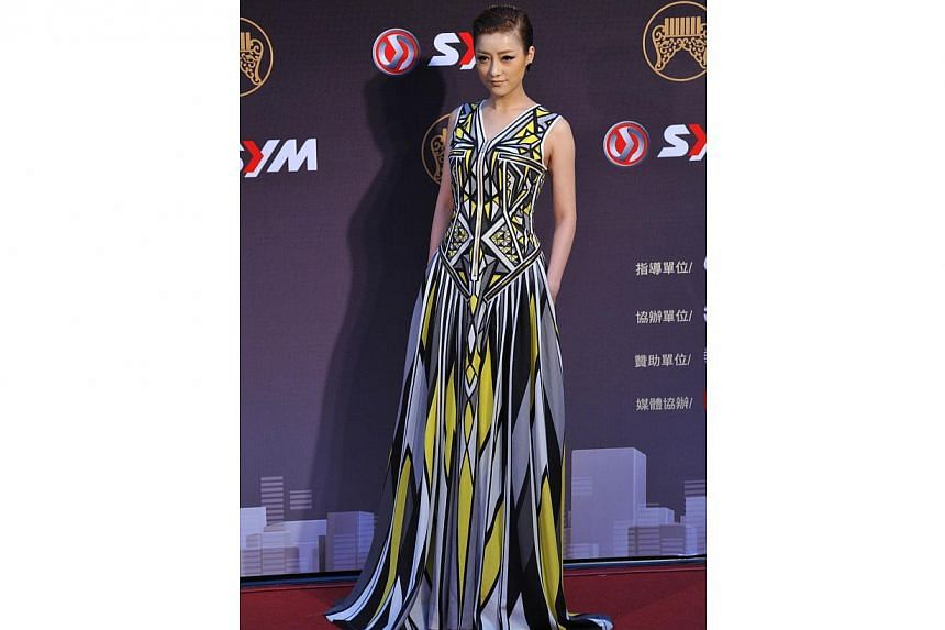 Chinese singer Sasha Li arrives at the 25th Golden Melody Awards in Taipei on June 28, 2014. -- PHOTO: AFP