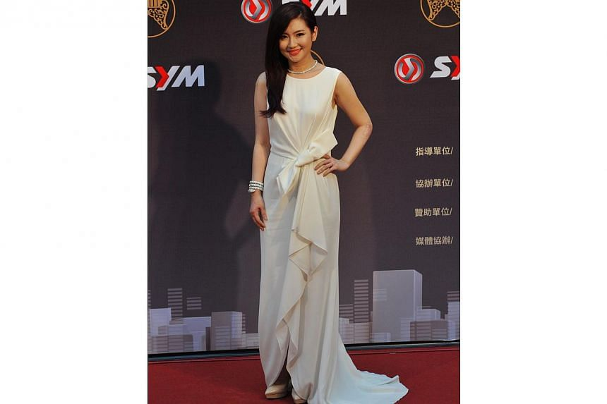 Taiwanese singer Selina Jen arrives at the 25th Golden Melody Awards in Taipei on June 28, 2014. -- PHOTO: AFP