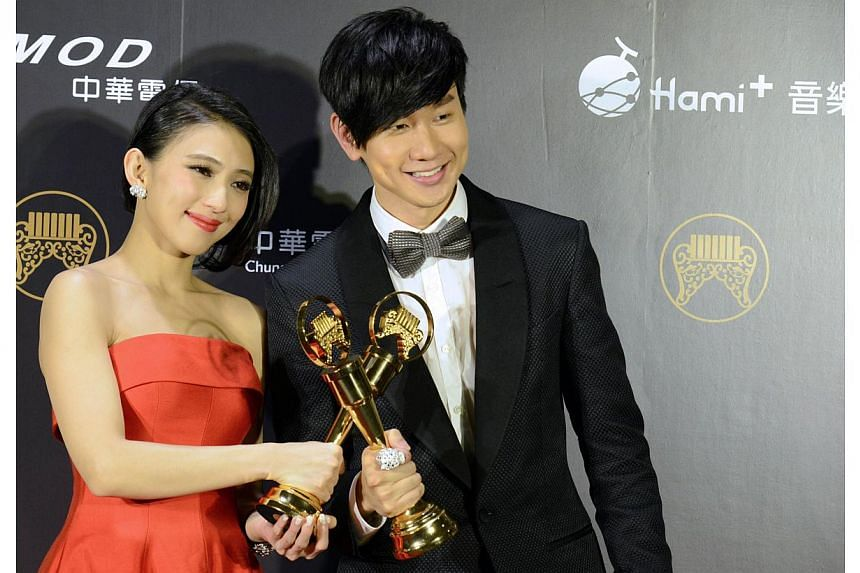 Singaporean singer-songwriter JJ Lin poses with his trophy after winning the Best Mandarin Male Singer at the 25th Golden Melody Awards in Taipei on June 28, 2014. -- PHOTO: AFP