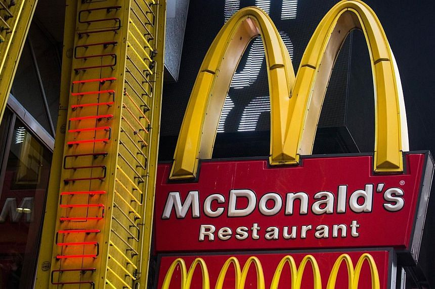 A sign for a McDonald's restaurant is seen in Times Squarein New York Cityon June 9, 2014. -- PHOTO: AFP