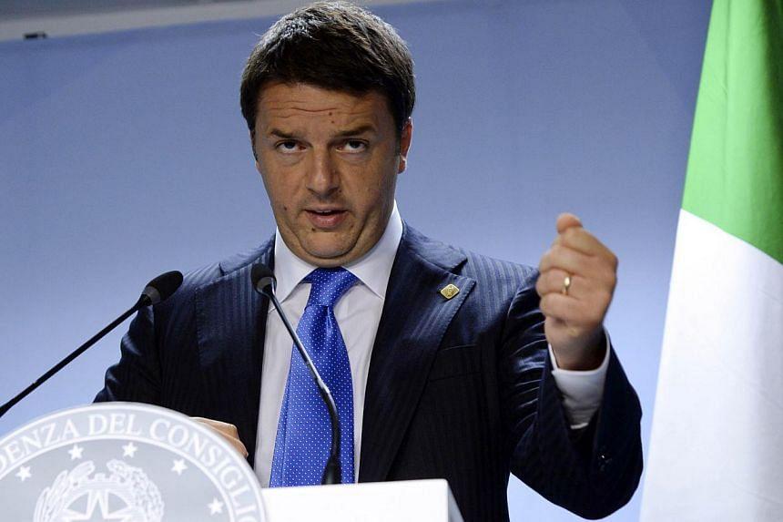 Italy's Prime Minister Matteo Renzi talks to the media at the end of an EU Summit held at the EU Council building in Brussels, on June 27, 2014. -- PHOTO: AFP