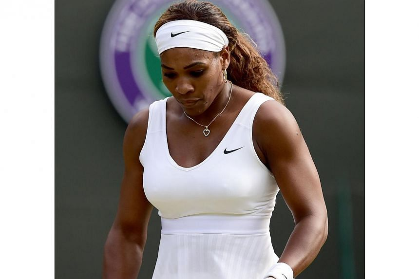 US player Serena Williams reacts during her women's singles third round match against France's Alize Cornet on day six of the 2014 Wimbledon Championships at The All England Tennis Club in Wimbledon, southwest London, on June 28, 2014. -- PHOTO: AFP