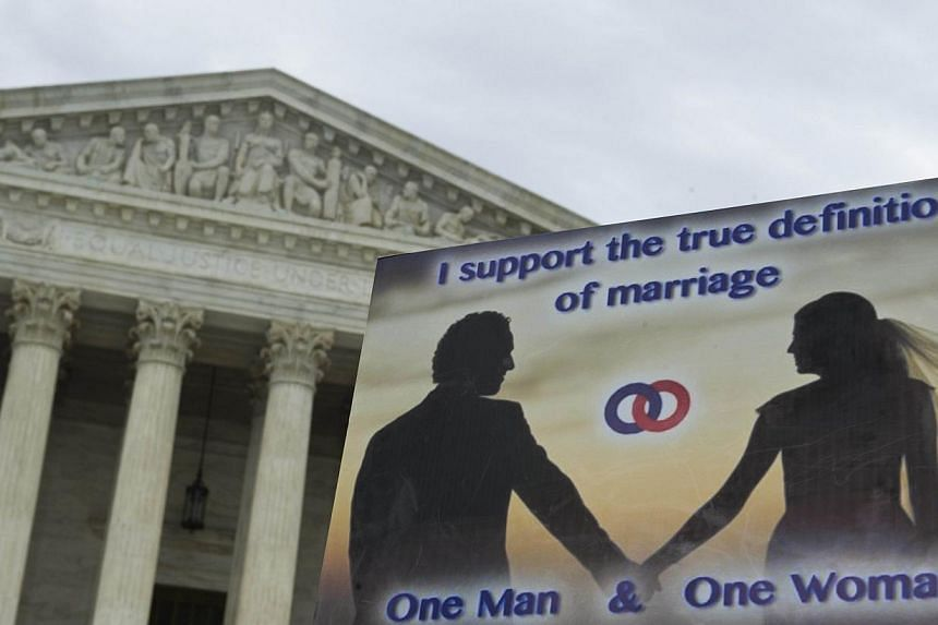 A sign supporting traditional marriage is seen during the second annual 'March for Marriage' on June 19, 2014 at the US Supreme Court in Washington, DC. The US Supreme Court will rule on Monday on whether an employer can cite religious beliefs as a r