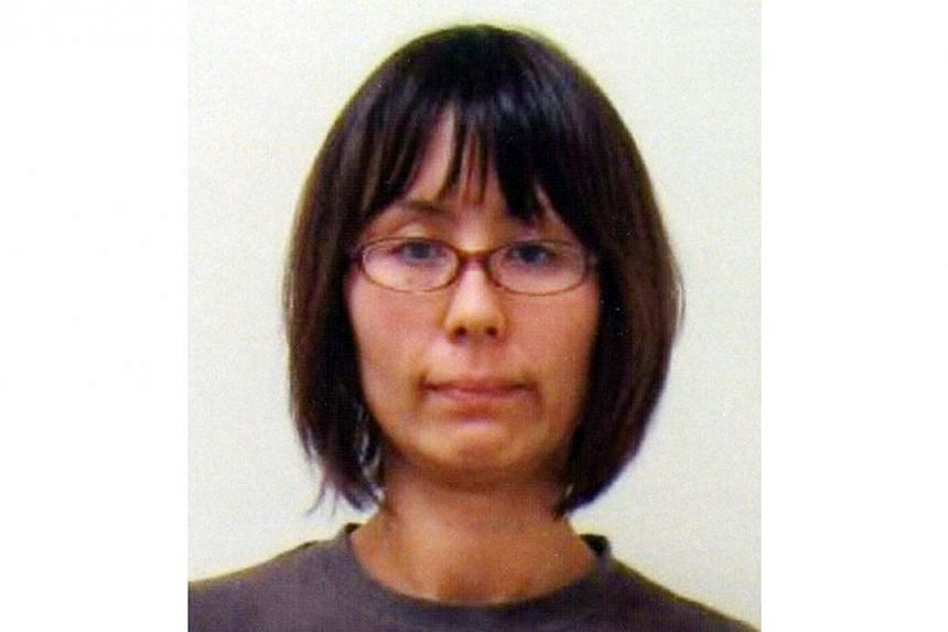 This handout file picture, released by Tokyo's Metropolitan Police department on June 4, 2012 shows Naoko Kikuchi, a former member of the doomsday cult Aum Supreme Truth in Tokyo.A former member of the Aum Supreme Truth cult, who spent 17 years