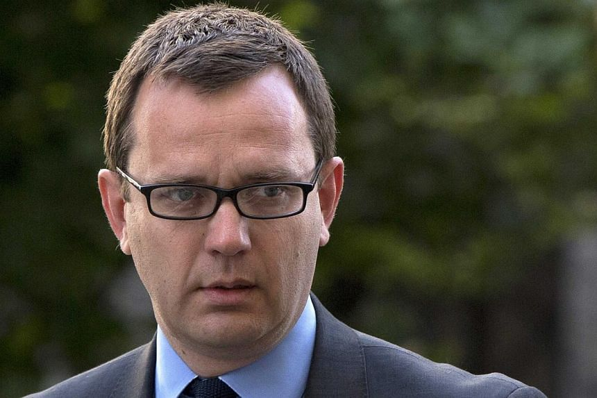 Andy Coulson (above), ex-media chief of British Prime Minister David Cameron, will face a re-trial over whether he sanctioned illegal payments to a public official while editing a Rupert Murdoch tabloid, prosecutors said on June 30, 2014. -- PHOTO: R