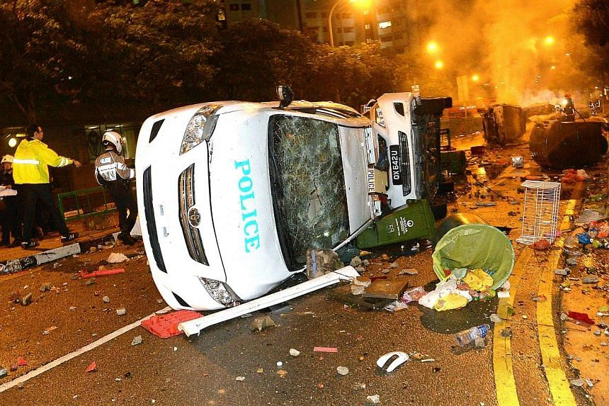 The overturned police cars at the aftermath of the Little India riot on 8 December 2013. -- ST PHOTO: DESMOND WEE