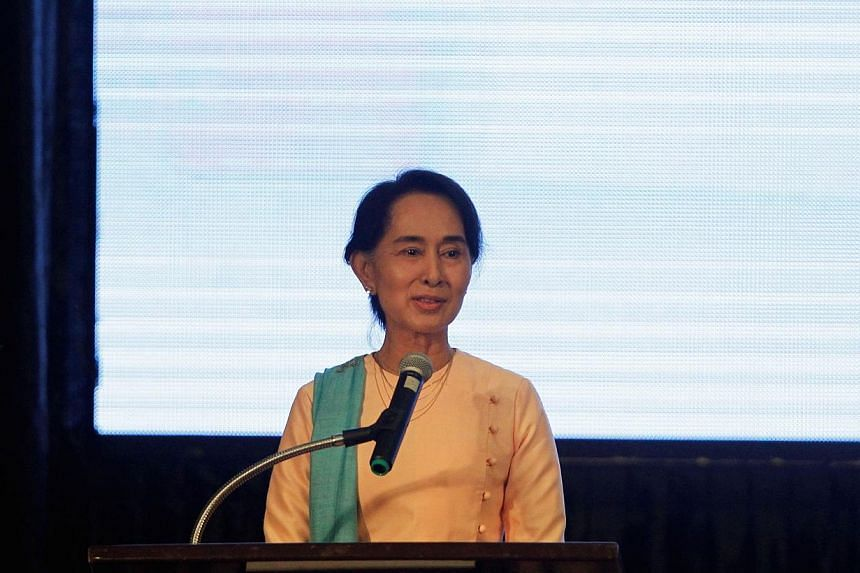 Myanmar opposition leader Aung San Suu Kyi speaks at the launch event for the State of the Tropics report, at Kandawgyi palace hotel in Yangon on June 29, 2014. Ms Suu Kyi is stepping up efforts to change a Constitution that bars her from the preside