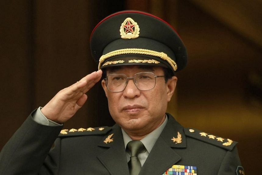 China's Central Military Commission vice-chairman General Xu Caihou listens to national anthems during a welcome ceremony at the Pentagon in Washington, in this October 27, 2009 file photo. -- PHOTO: REUTERS