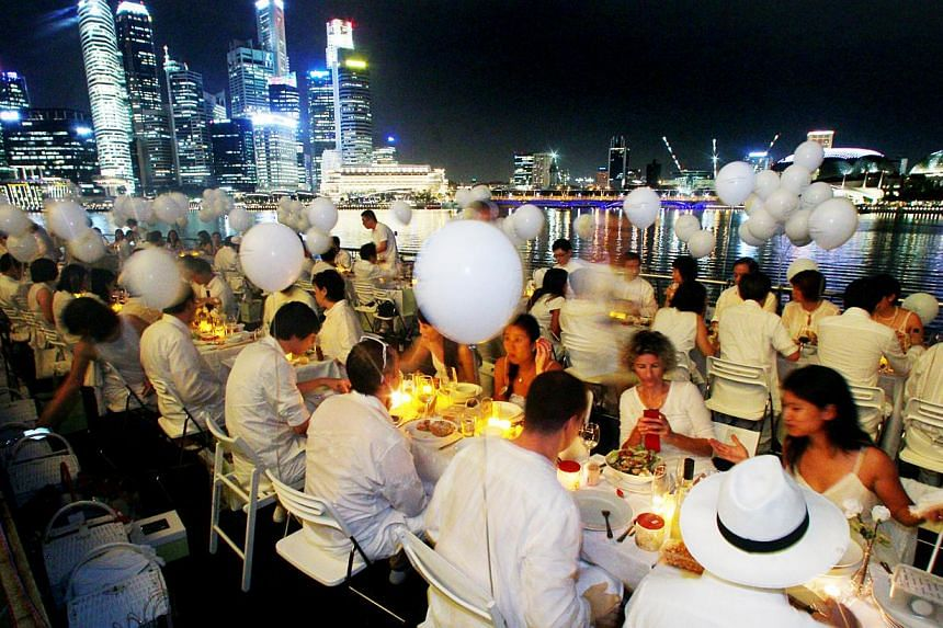 Participants of Diner en Blanc or The White Dinner, a fancy and impromptu picnic. -- PHOTO: ST FILE