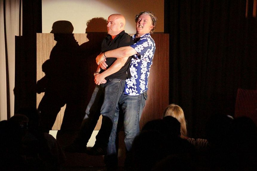 The pint-sized Ian Coppinger (left) being carried by cast member Andy Smart. Coppinger (below bottom right) will perform in Singapore with (clockwise from top left) Smart, Stephen Frost and Steve Steen.