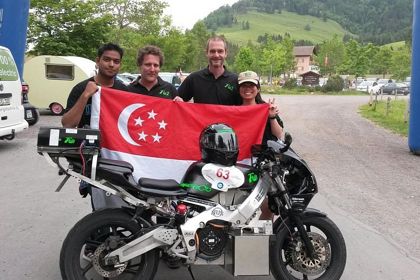 Seen here with the converted electric motorcycle at Seebodenalp, Switzerland, are several members of the NUS team. From left: Mr Ayush Pacheriwala, Dr JJorg Weigl, Professor Martin Henz and Ms Pek Yang Xuan.