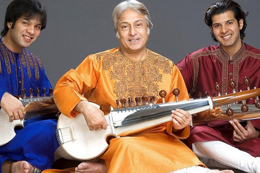 In his 50-year career, Amjad Ali Khan (centre) has elevated the sarod - a 16th-centuryIndian string instrument - to being one of the most popular instruments in Indianclassical music. He is seen here flanked by his sons Amaan and Ayaan Al