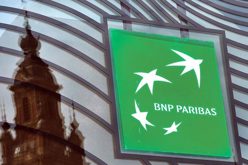 A photo taken on June 24, 2014 in Lille, northern France shows the logo of the French bank BNP Paribas.French bank BNP Paribas has agreed to pay US authorities a US$8.9 billion (S$11.1 billion) fine to avoid being tried in court for dealing wit