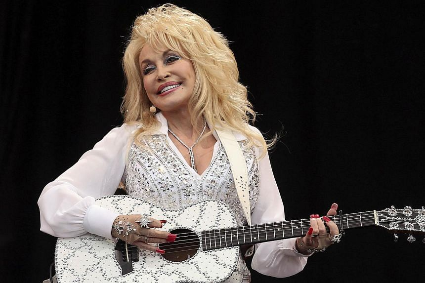 American country music star Dolly Parton performs on the Pyramid Stage at Worthy Farm in Somerset, during the Glastonbury Festival on June 29, 2014. Country music star Dolly Parton drew the biggest crowd of Britain's Glastonbury music festival
