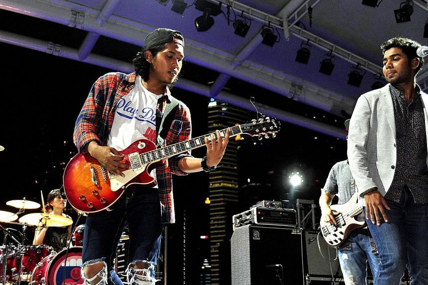(From left) Tammy as drummer, Nicco as lead guitarist and Zamir as vocals of WhenTheKidsAreSurreal. -- DIOS VINCOY JR FOR THE STRAITS TIMES