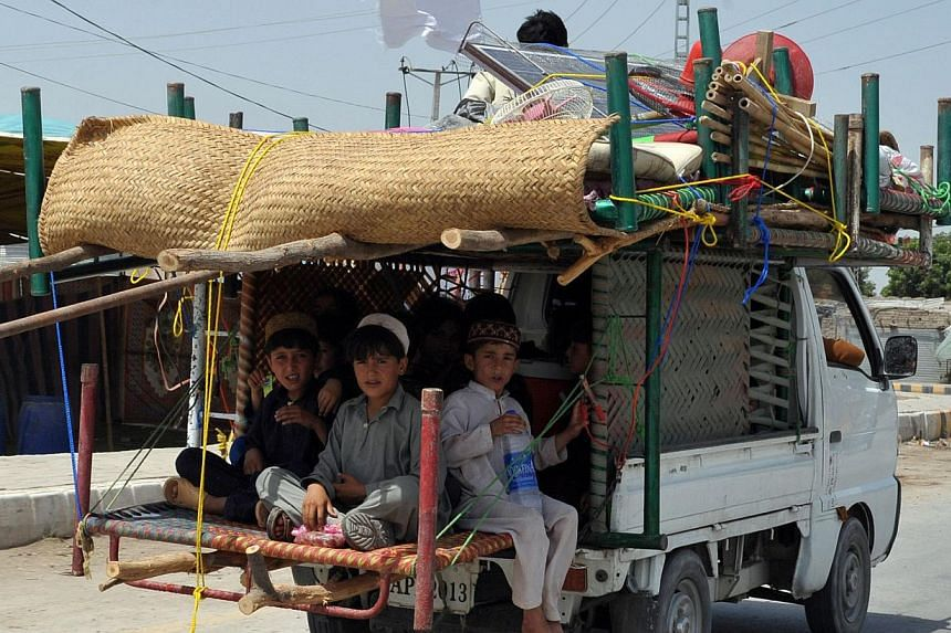 Newly internally displaced Pakistani civilians fleeing a military operation against Taleban militants in North Waziristan tribal area on June 28, 2014. Pakistan military have launched a ground assault against the militants after two weeks of air stri