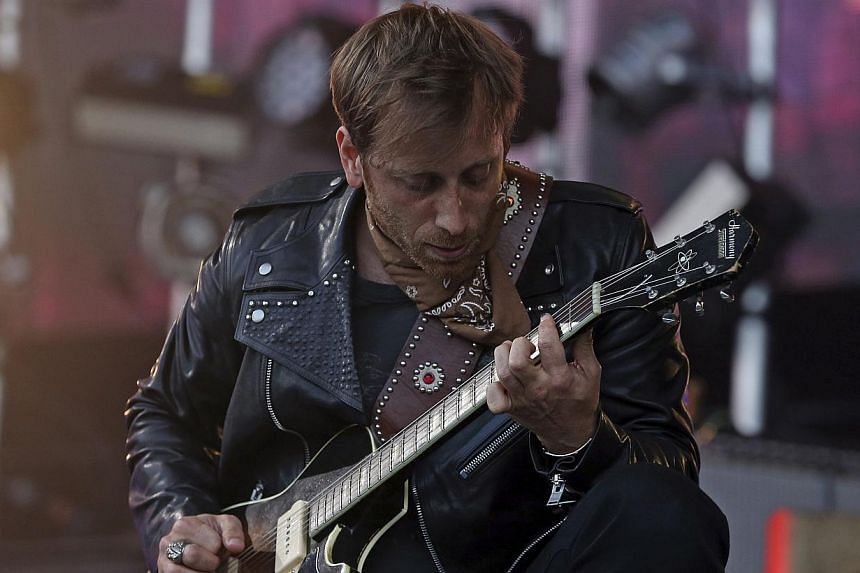 Black Keys frontman Dan Auerbach performs on the Pyramid stage at Worthy Farm in Somerset, during the Glastonbury Festival on June 29, 2014. -- PHOTO: REUTERS