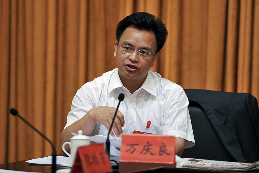 In this photograph taken on May 11, 2012, Guangzhou's Chinese Communist Party secretary Wan Qingliang attends a meeting in Guangzhou in south China's Guangdong province. -- PHOTO: AFP